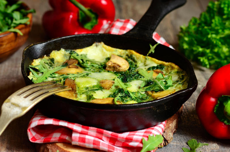 Omelet with mushrooms,cheese,spinach and arugula. stock images