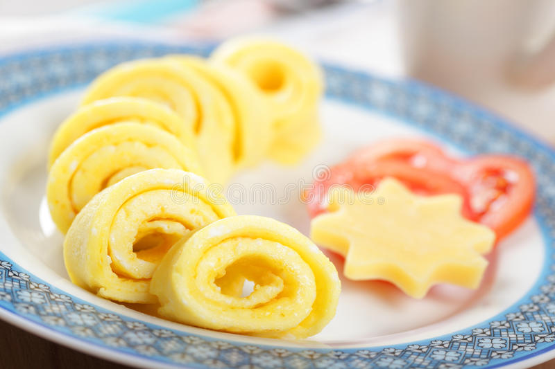 Omelet roll with cheese and tomato royalty free stock image