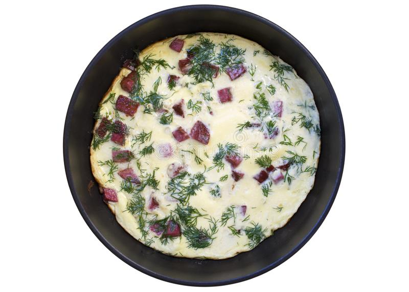 Omelet with sausage and dill in a pan. Top view. Fried eggs for breakfast on white background, isolate royalty free stock image