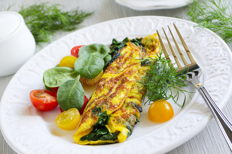 Omelet with spinach royalty free stock image