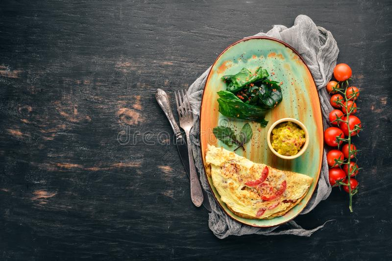 Omelet with spinach and tomatoes. royalty free stock images
