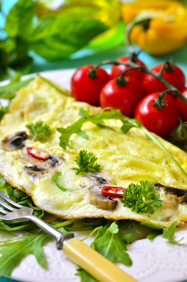 Omelet stuffed with champignon and cheese. stock images