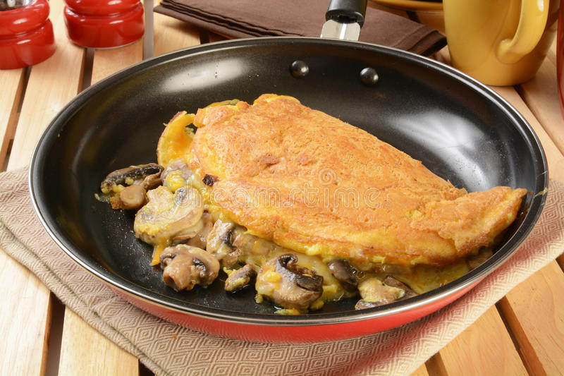 Omelet with swiss cheese and mushrooms royalty free stock photo