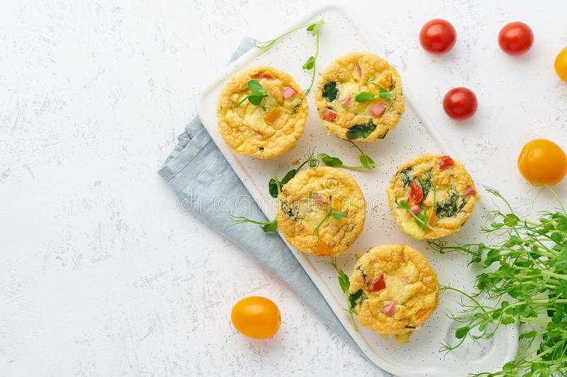 Omelet with tomatoes and bacon, baked eggs with spinach and broccoli, top view with copy space, keto, ketogenic diet royalty free stock photos