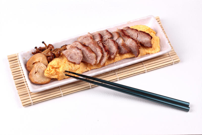 Omelet topped pork steak and grilled mixed mushroom. Homemade ,Omelet topped pork steak and grilled mixed mushroom in Japanese style stock image