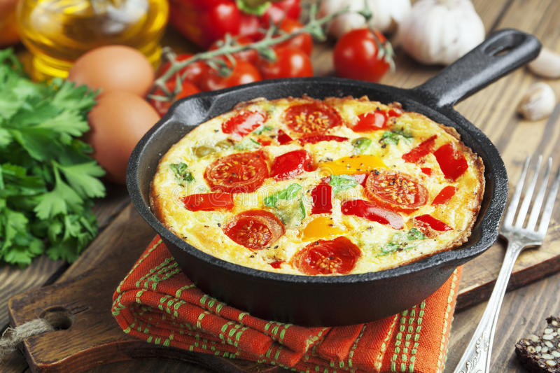 Omelet with vegetables and cheese. Frittata royalty free stock image