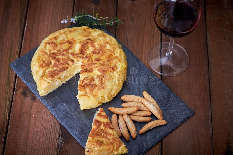 Omelette with bread stick and wine glass stock images