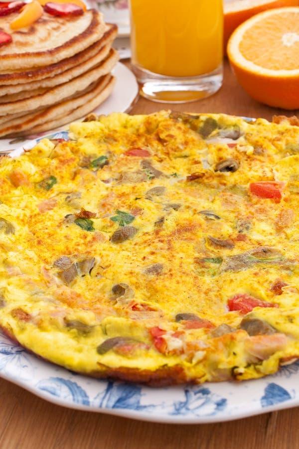 Omelette breakfast. Breakfast of omelette, pancakes and orange juice stock images