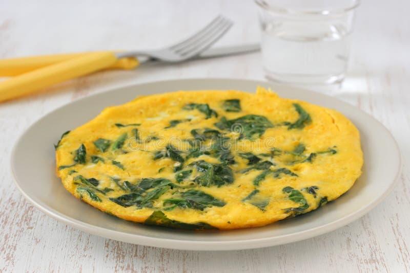Omelette con spinaci fotografia stock