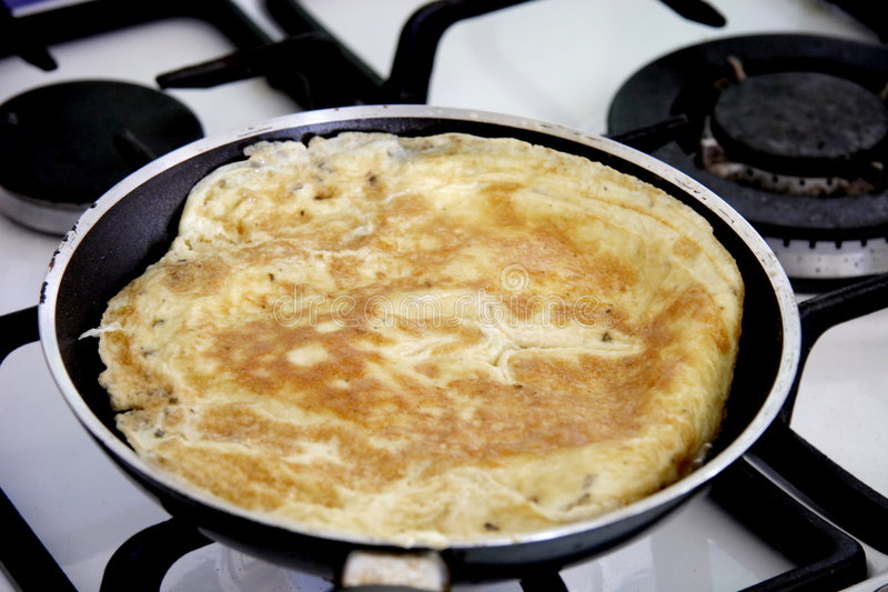 Omelette cooking royalty free stock photo