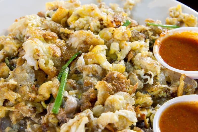 Omelette d'huître avec de la sauce à /poivron photographie stock