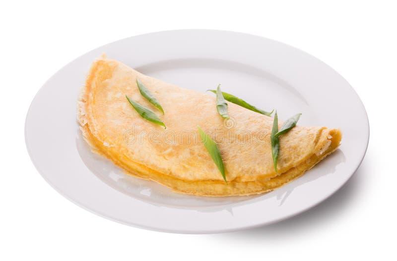 Omelette d'un plat blanc photo stock