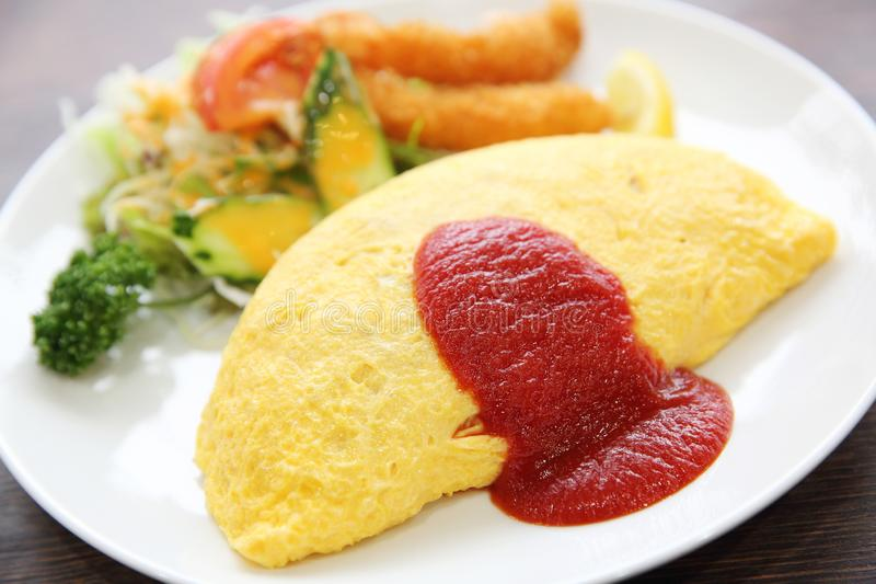 Omelette with fried rice and shrimp tempura Japanese food. Omelette with fried rice and shrimp tempura on a plate , Japanese food stock images