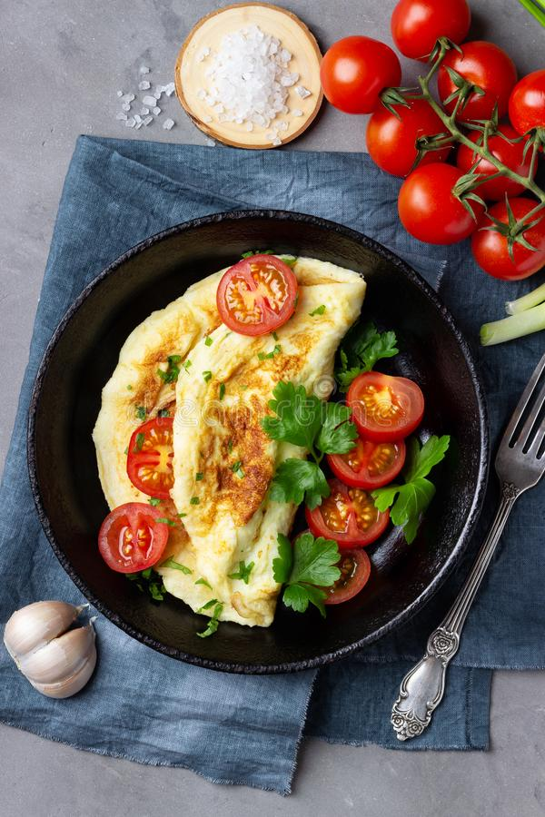 Omelette in frying pan on stone background. Top view royalty free stock photo