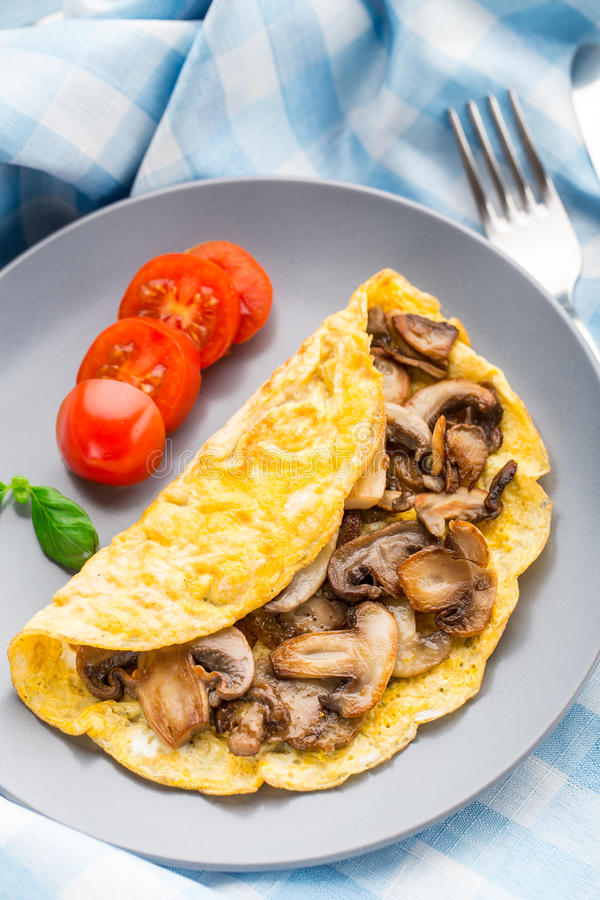 Omelette with mushrooms stock images