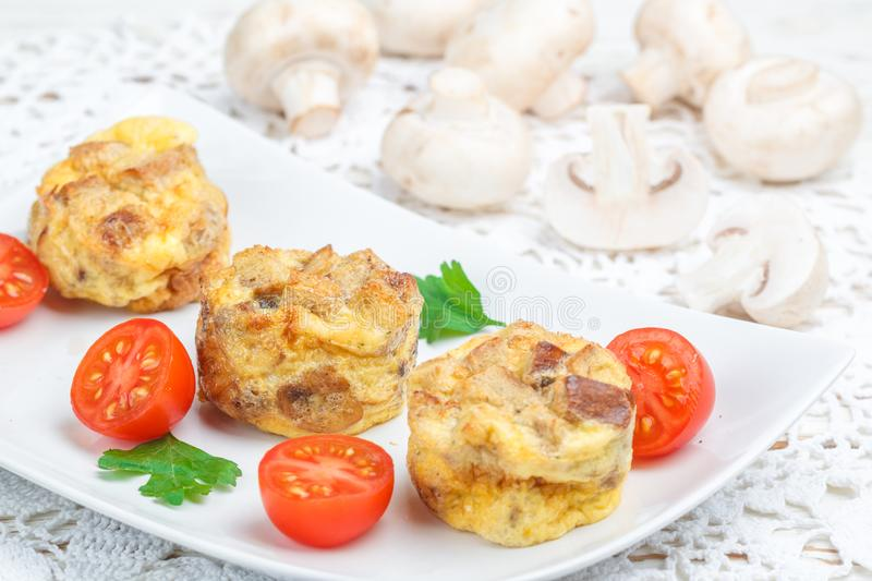 Omelette with mushrooms, parsley, cherry tomatoes and bread croutons royalty free stock images