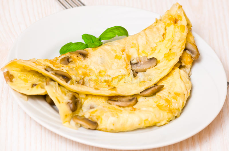 Omelette with mushrooms. On plate royalty free stock photos