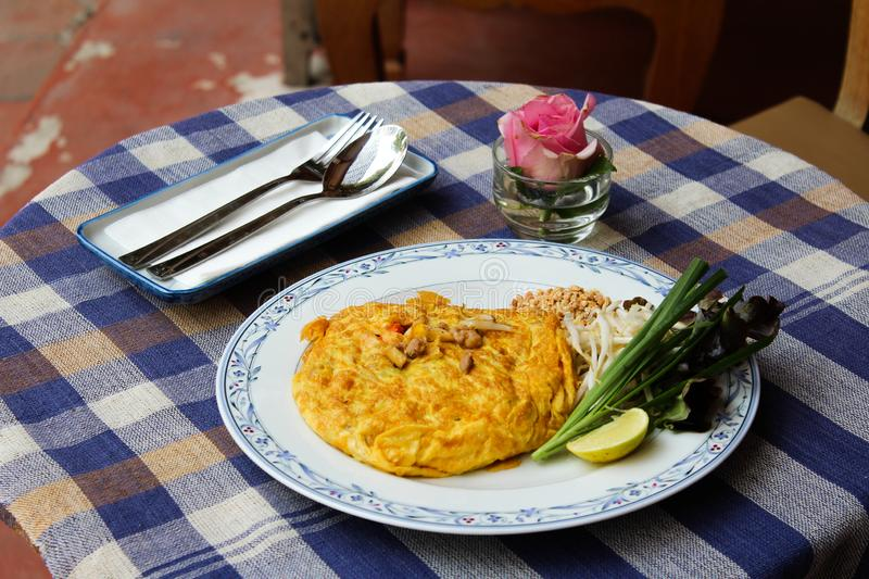 Omelette pad thai. Omelet pad thai inside, delicious thai dish royalty free stock photo