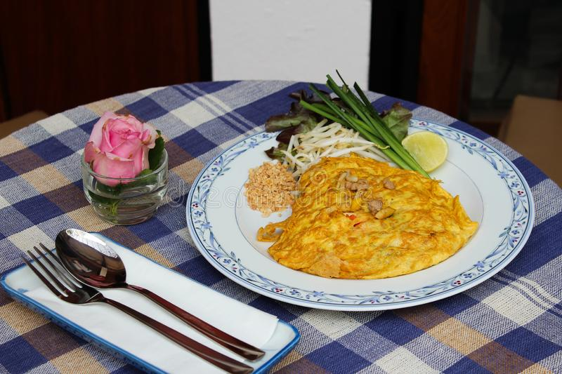 Omelette pad thai. Omelet pad thai inside, delicious thai dish royalty free stock photos