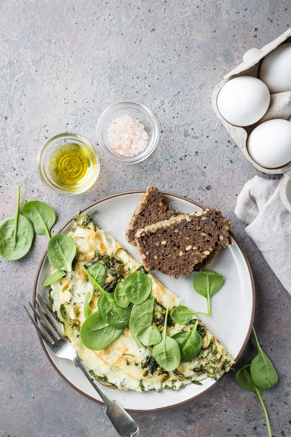 Omelette stuffed with spinach. And cheese for healthy breakfast, top view stock photography