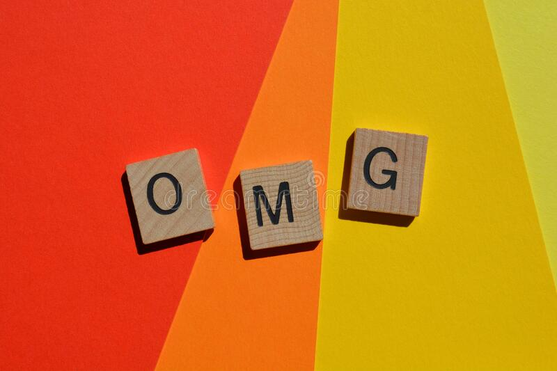 OMG, internet slang or text speak. OMG, acronym for Oh My God, isolated on brightly coloured background royalty free stock photo