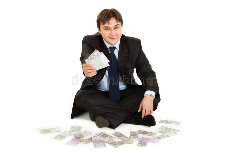 omgiven sitting för affärsmangolvpengar arkivbilder