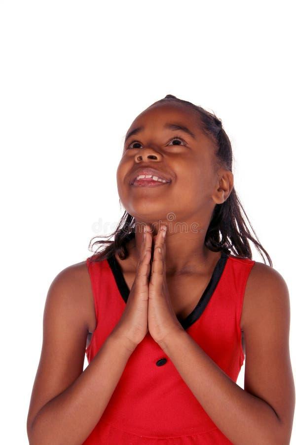 Omhoog het kijken aangezien zij bidt stock foto's