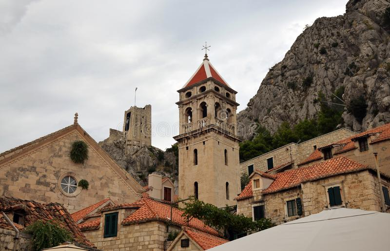 Omiš, Croatia - Old town with church and Mirabela fortress stock image