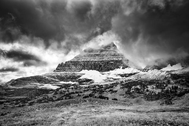 Ominous Clouds on Hidden Lake Trail. Ominous clouds blanketing the peaks in Glacier National Park, MT stock images