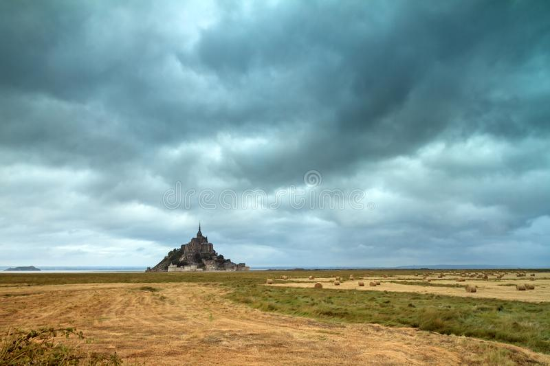 Ominous clouds at Le Mont Saint-Michel. Beautiful view of historic landmark Le Mont Saint-Michel in Normandy, France, a famous UNESCO world heritage site and royalty free stock images