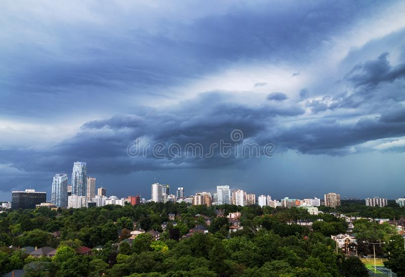 Ominous clouds over Midtown Toronto. Ominous gray and blue clouds over Midtown Toronto on a summer day stock image