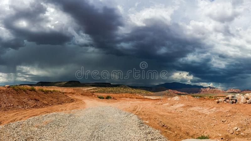 Ominous Stormy Sky and Cumulus Clouds and Rain in the Desert. Ominous Dark Stormy Sky and Cumulus Clouds with Rain in the Desert royalty free stock photography