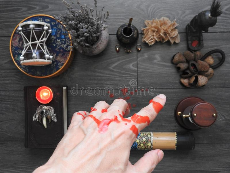 An ominous mystical ritual. The hand of the magician. Occultism. Divination. The Concept Of Halloween. Black magic stock images