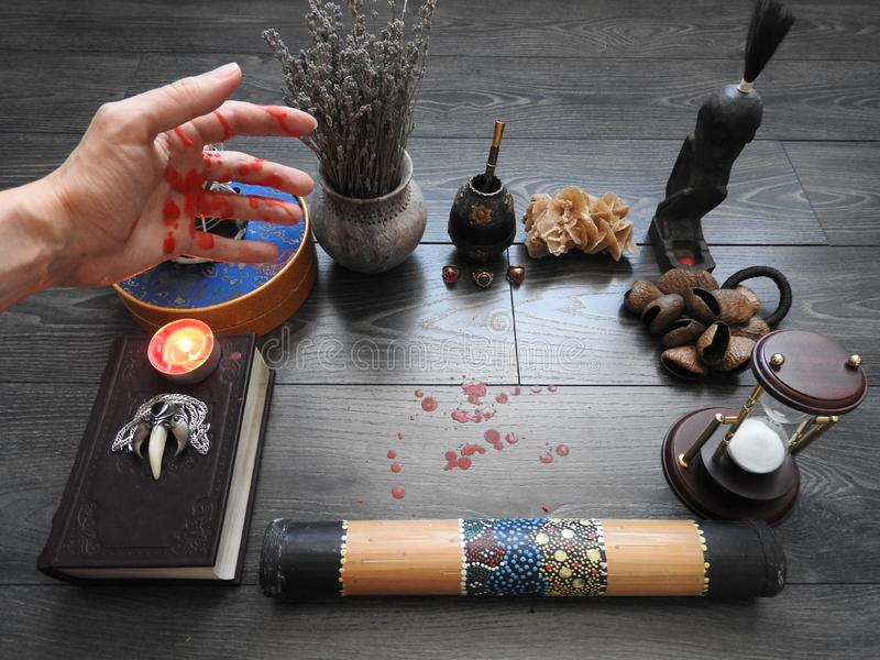 An ominous mystical ritual. The hand of the magician. Occultism. Divination. The Concept Of Halloween. Black magic.  stock photo