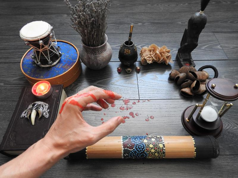 An ominous mystical ritual. The hand of the magician. Occultism. Divination. The Concept Of Halloween. Black magic.  stock photos