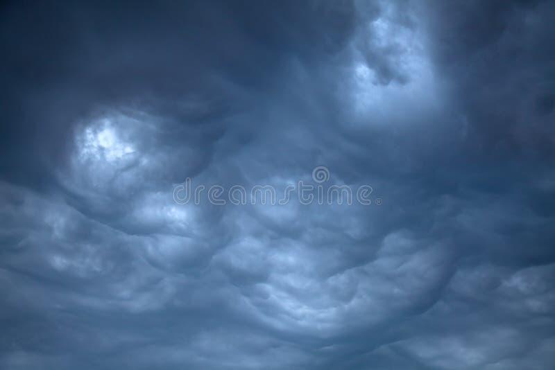 Ominous Rain Clouds. Dark, Ominous Rain Clouds before the thunder storm royalty free stock photo