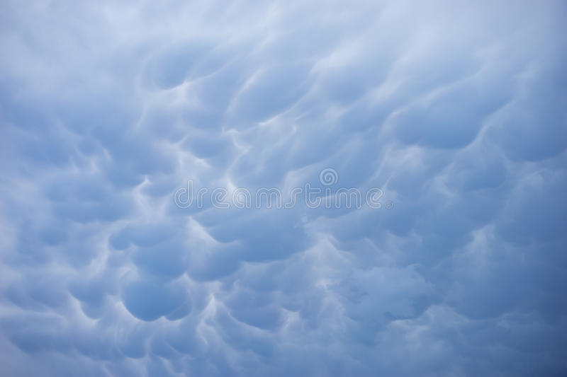 Ominous rain clouds. Blue ominous rain clouds before a storm. Great for a desktop wallpaper stock images