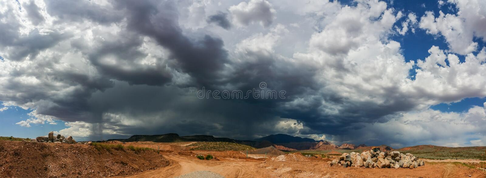 Ominous Stormy Sky and Cumulus Clouds with Rain Pano in the Desert.  royalty free stock photo