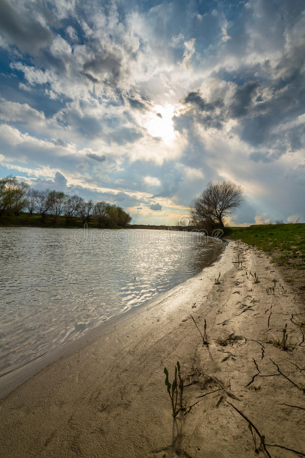 Ominous stormy sky over natural flooded river royalty free stock photos