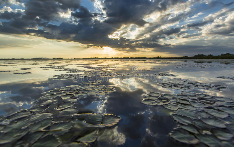 Ominous stormy sky reflection over natural lake stock photo