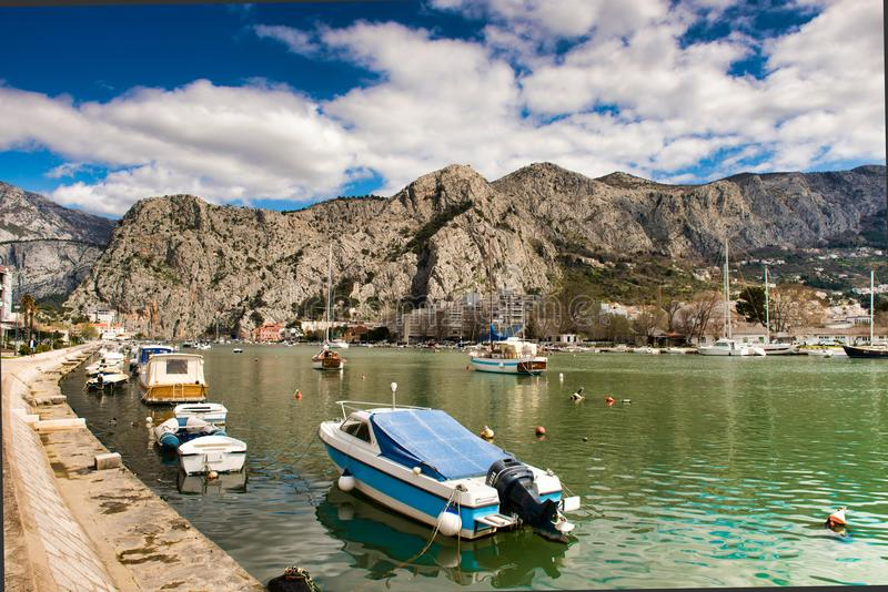 Omis Croatia karst mountains. Jagged karst mountains abut the boatharbour and Adriatic sea on the Croatian coast near Omis, south of Split royalty free stock photo