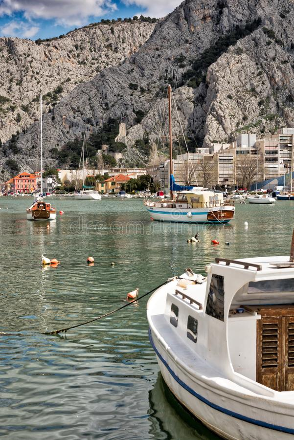 Omis Croatia karst mountains. Jagged karst mountains abut the boatharbour and Adriatic sea on the Croatian coast near Omis, south of Split royalty free stock images