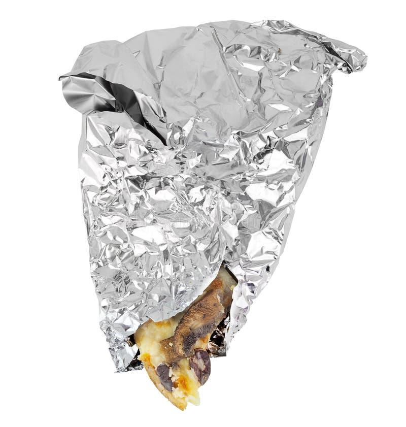Omkullkasta den slågna in pizzaskivan royaltyfri foto
