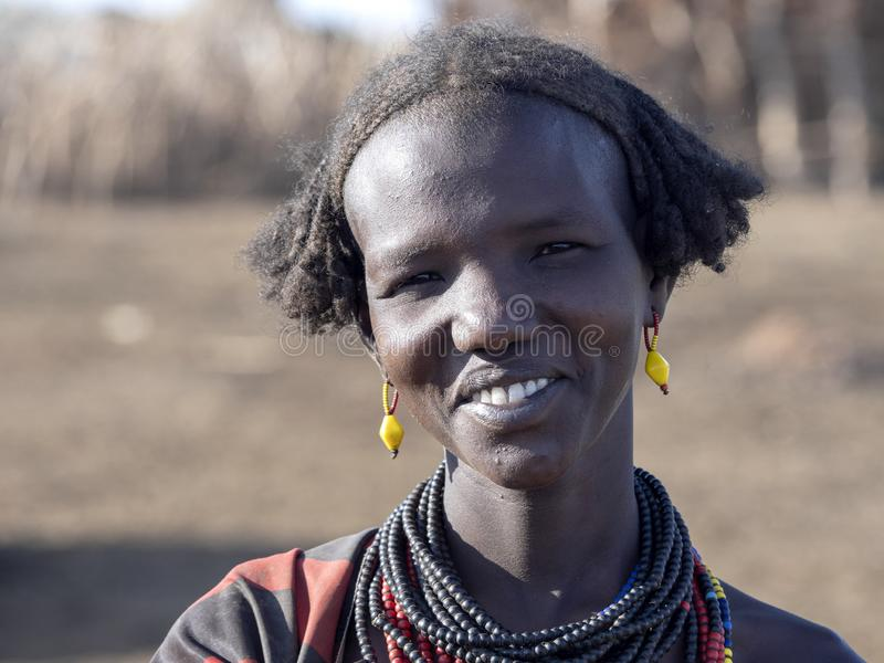 OMO RIVER, ETHIOPIA, MAY 11TH. 2019, Portrait of girl of Dassanech tribe, May 11Th. 2018 dating in Omo river, Ethiopia. Portrait of girl of Dassanech tribe, May stock photography