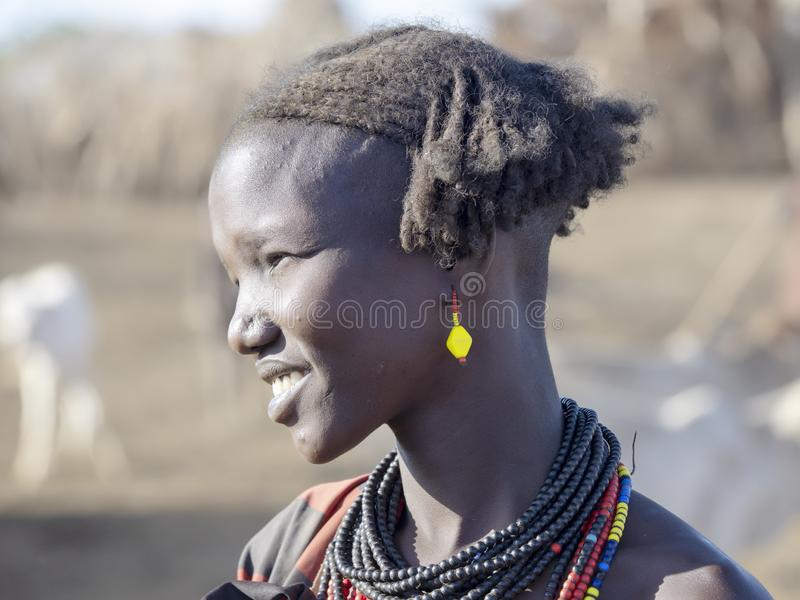 OMO RIVER, ETHIOPIA, MAY 11TH. 2019, Portrait of girl of Dassanech tribe, May 11Th. 2018 dating in Omo river, Ethiopia. Portrait of girl of Dassanech tribe, May royalty free stock photography