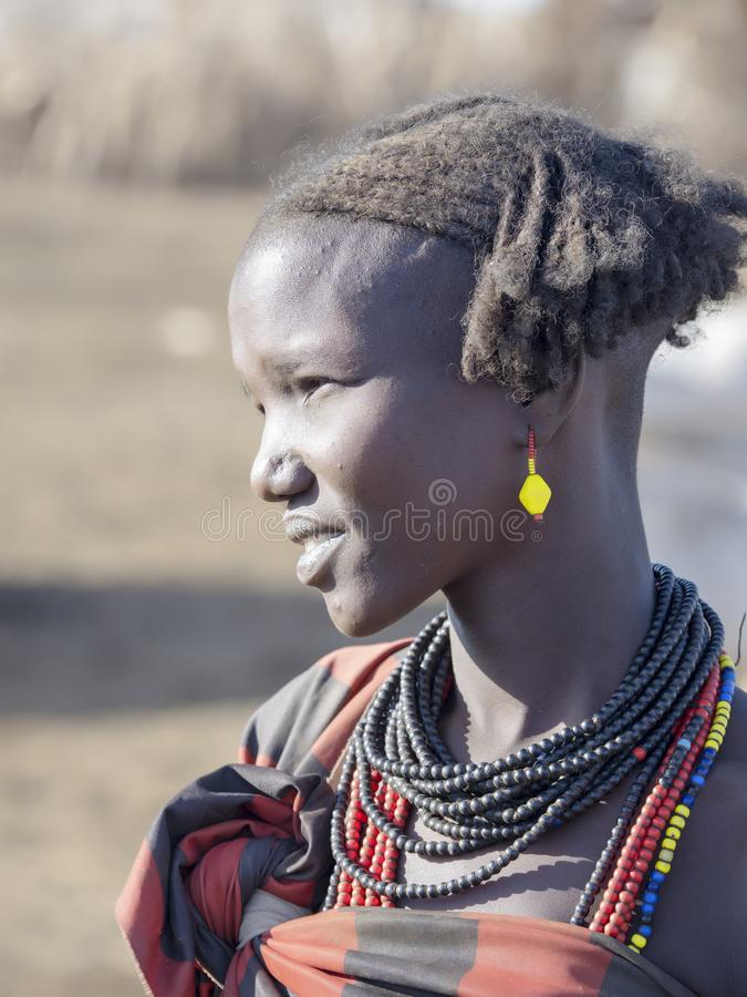 OMO RIVER, ETHIOPIA, MAY 11TH. 2019, Portrait of girl of Dassanech tribe, May 11Th. 2018 dating in Omo river, Ethiopia. Portrait of girl of Dassanech tribe, May stock image