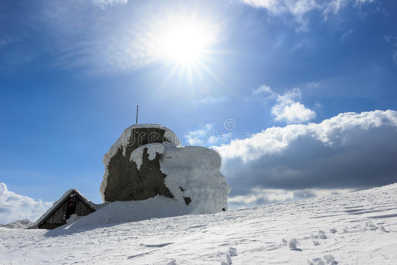 Omu peak and shelter,Bucegi mountains,Southern Carpathians,Romania. Winter sunshine in a Bucegi mountains,Omu peak,Carpathians,Romania royalty free stock photos