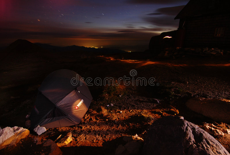 Omu Shelter View. The beautiful night sky lit by the city of Busteni as seen from the Omu Shelter in the Velea Alba climbing area royalty free stock images