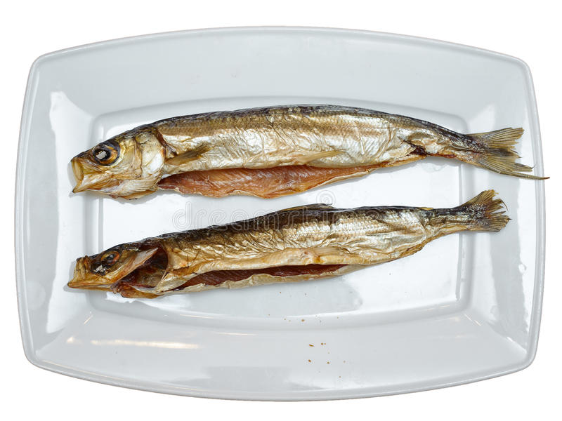 Omul. Smoked fishes on the plate stock image