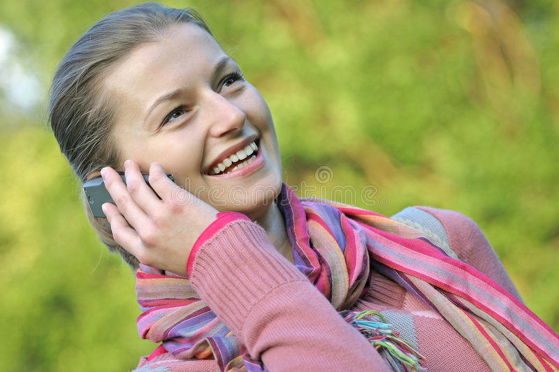Download Ona a phone in the park stock image. Image of calling, colourful - 453887